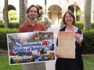 From left: Michael holds a promotional poster image and Jean shows their official 450th Alliance contract
